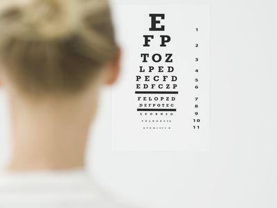 Woman looking at eye chart