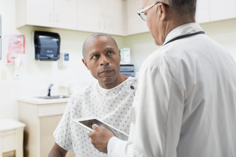 Doctor comforting patient who has crooked erections after prostate surgery