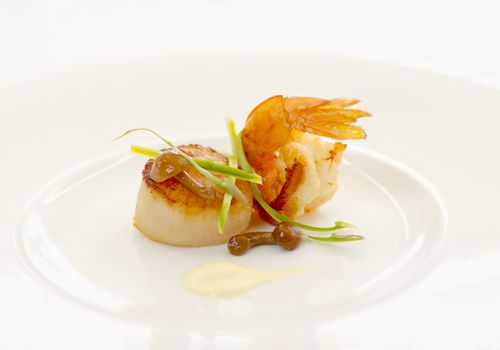 Shrimp and scallop on a white plate
