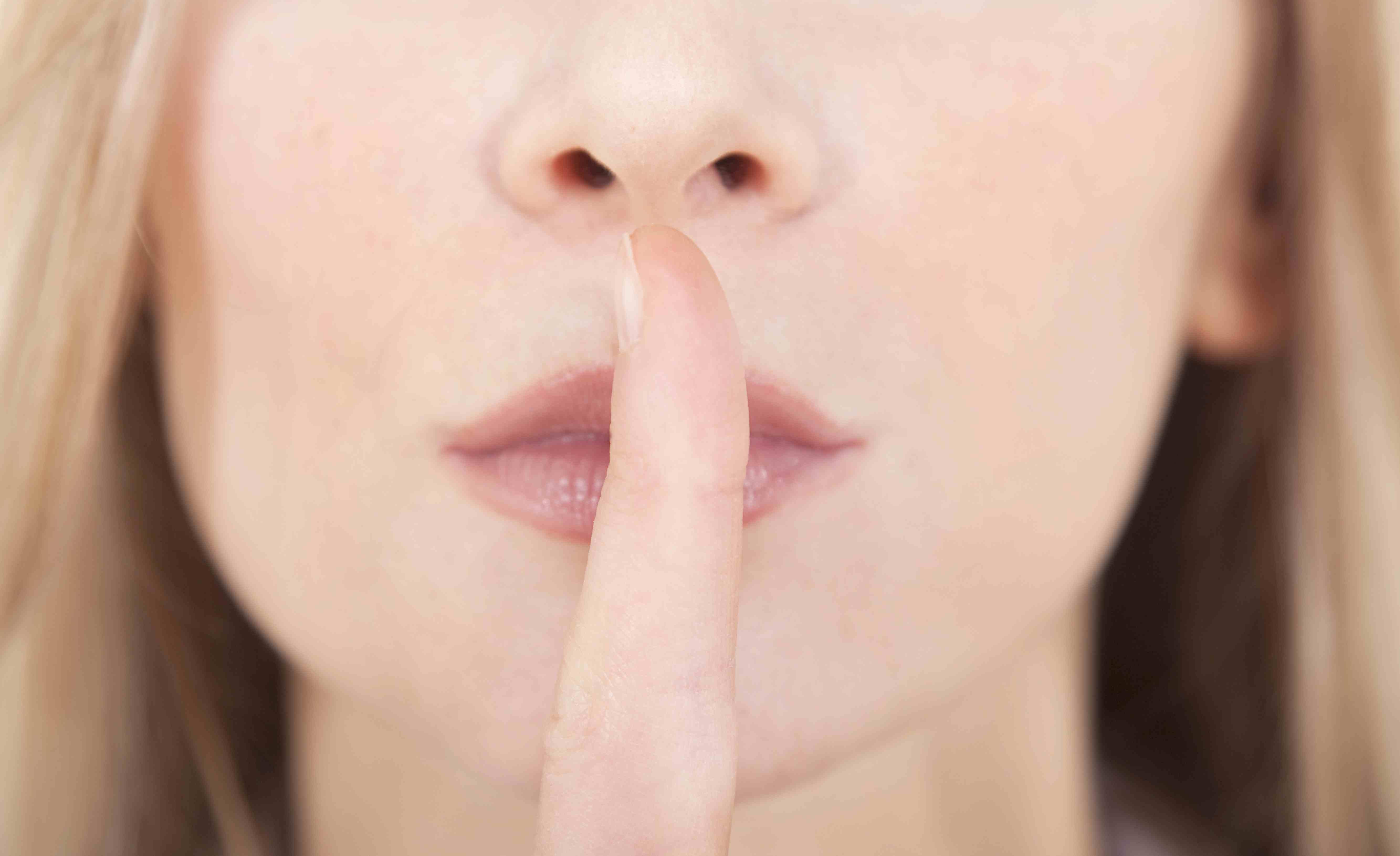 Woman saying shush