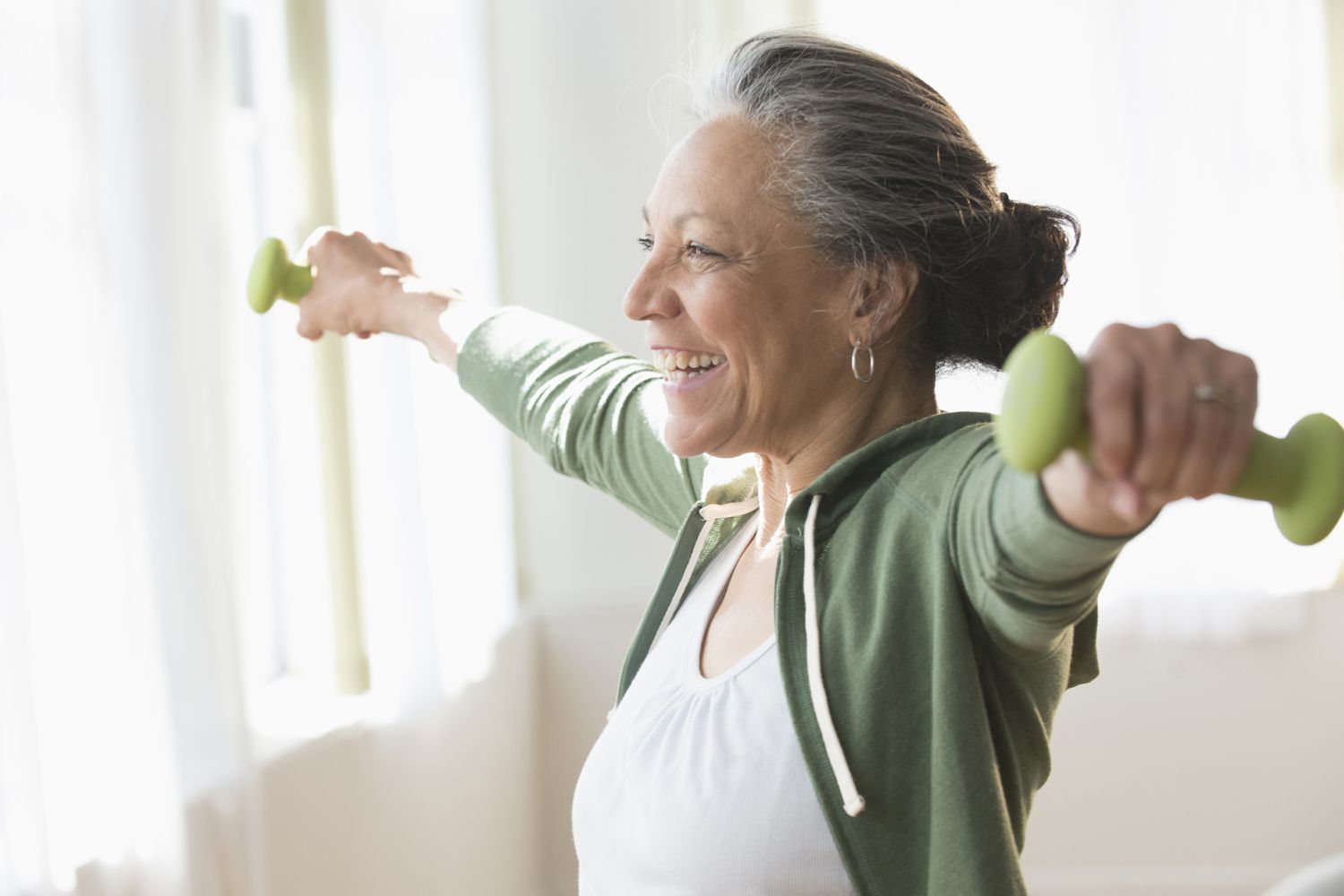 Older woman working out with weights