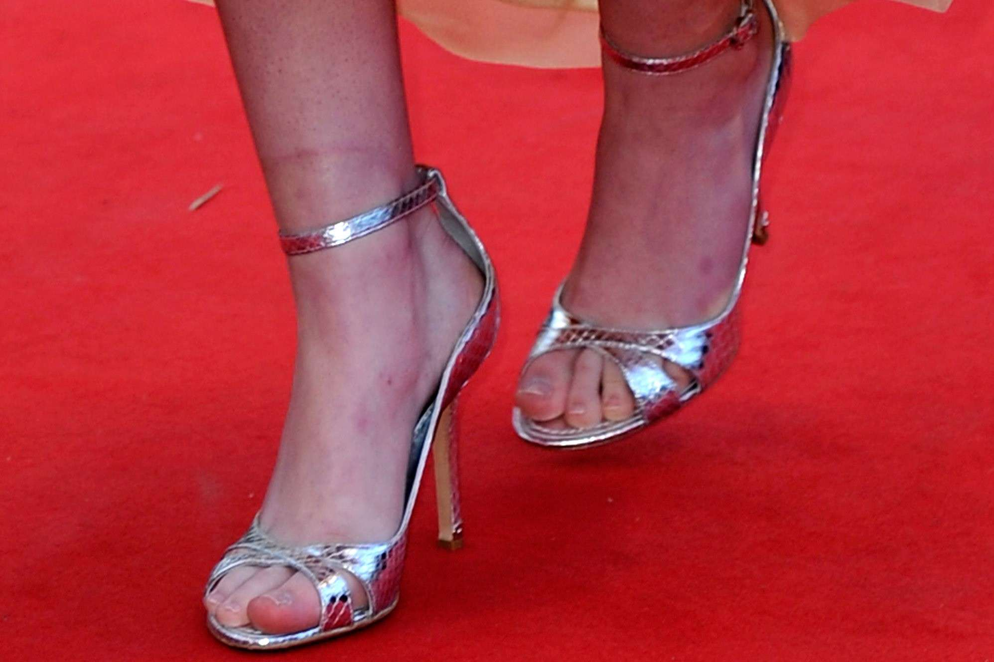 Woman wearing silver high heeled sandals