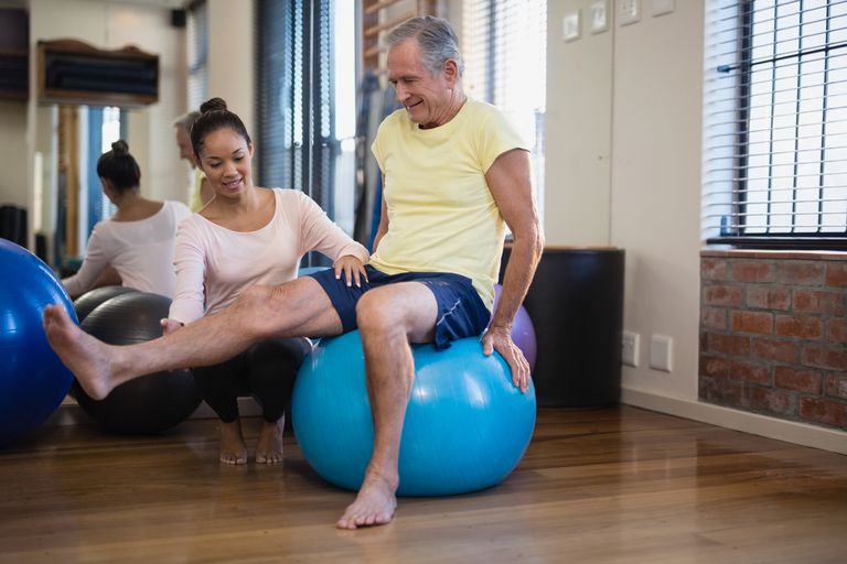 Senior man working with a physical therapist