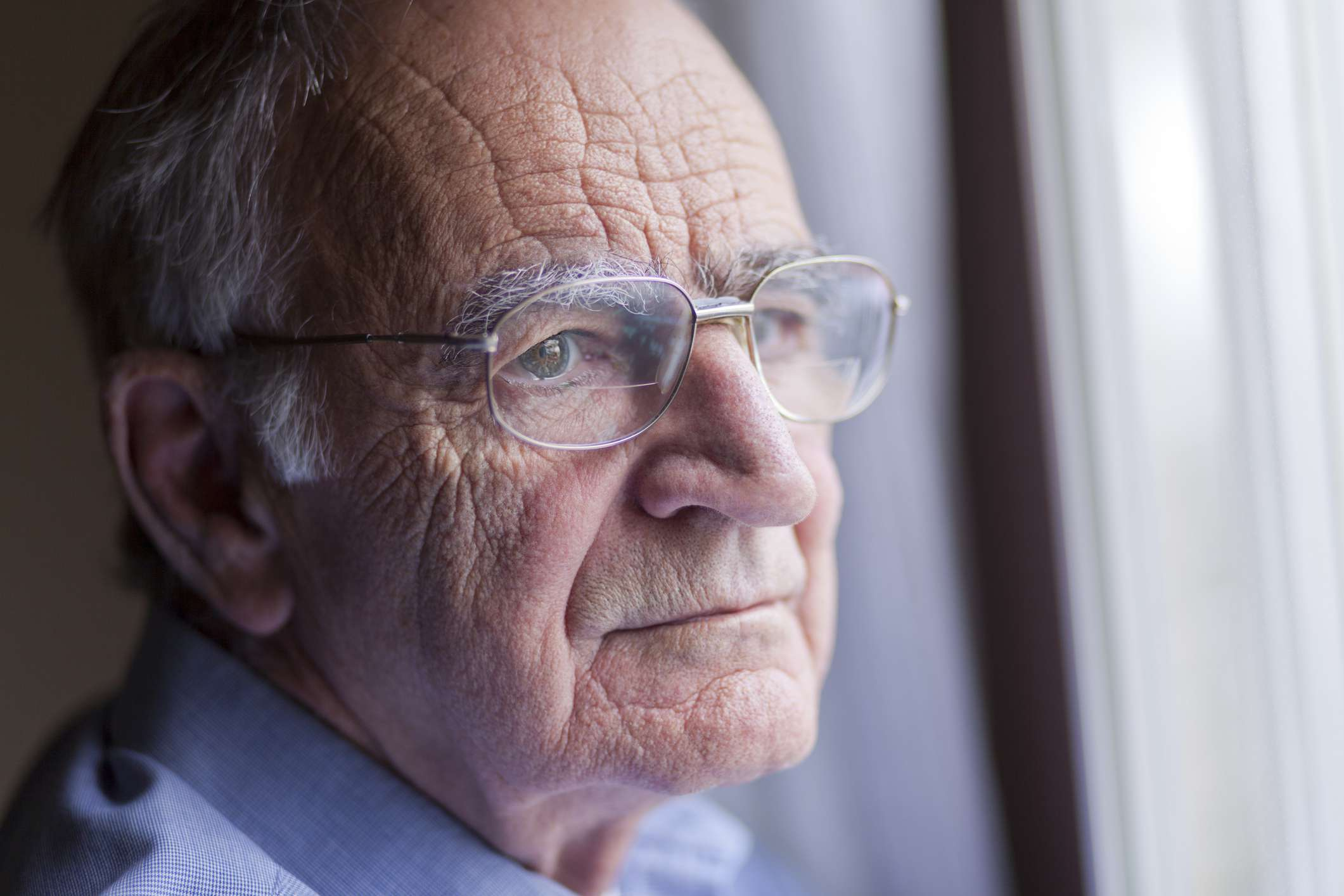An older man looking out the window