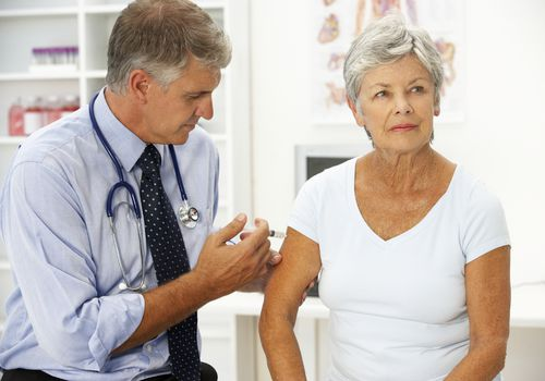 Woman with cancer getting one of the recommended immunizations