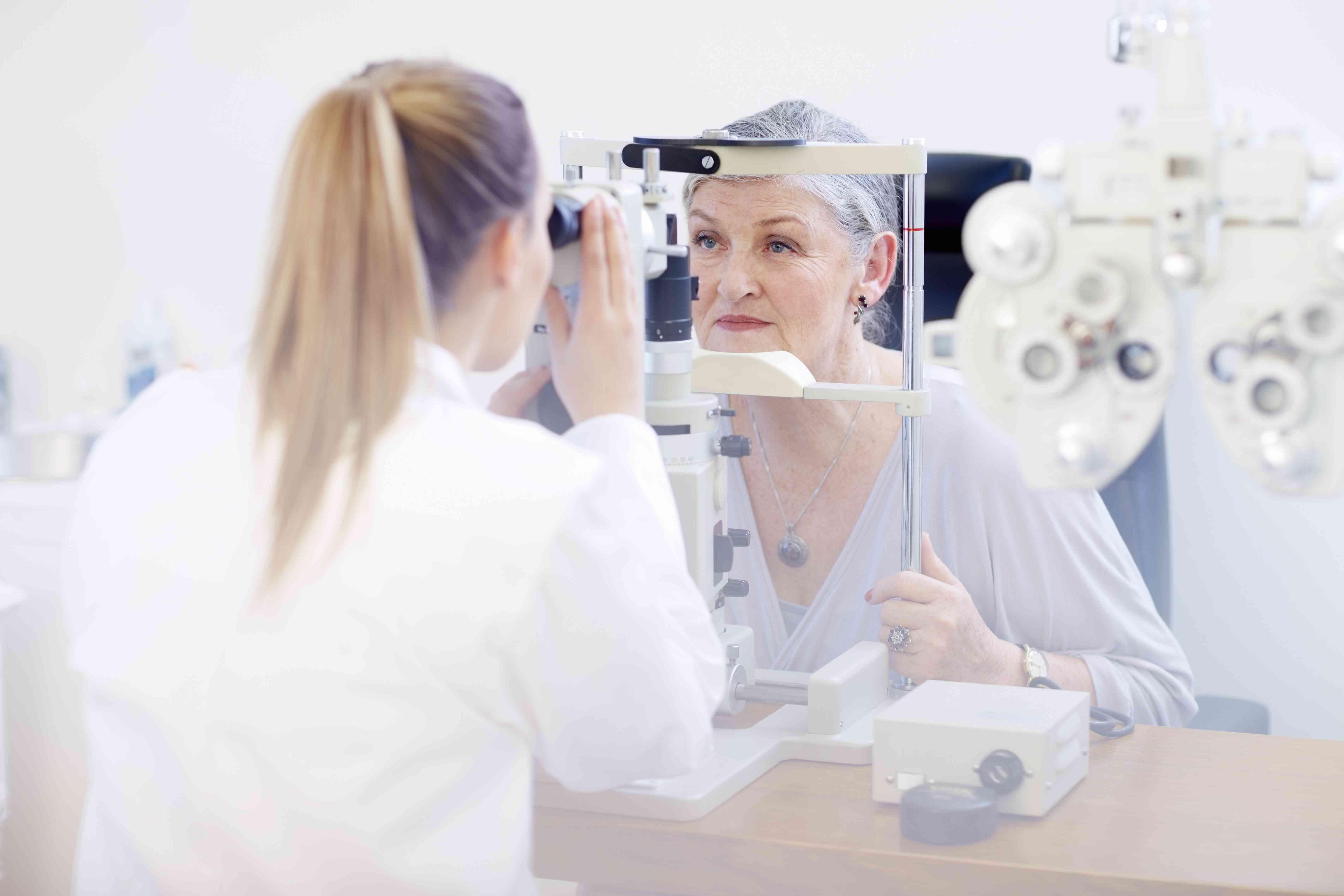 Eye doctor examining senior womans vision