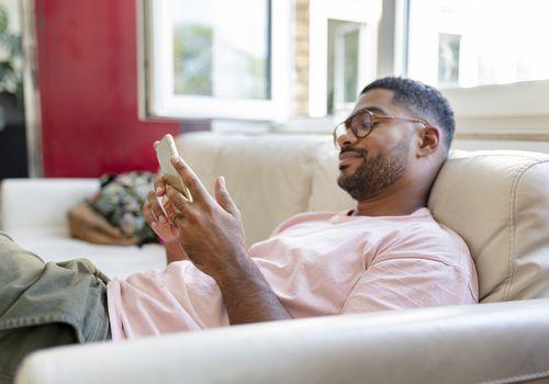 Man scrolling on phone.