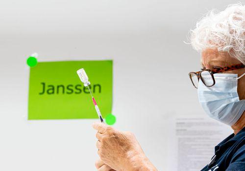 Woman administering Janssen vaccine