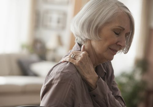 elderly woman with shoulder pain