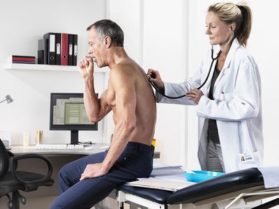 Doctor listening to patient's cough