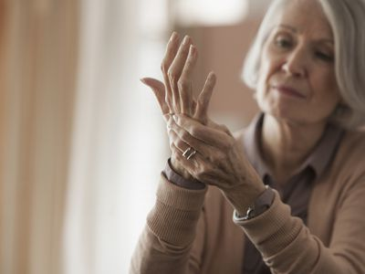 elderly woman with hand pain