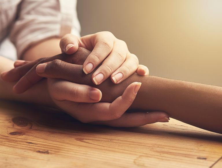 Close up of two people holding hands