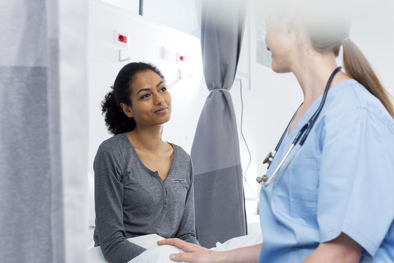 Young woman consulting with her doctor