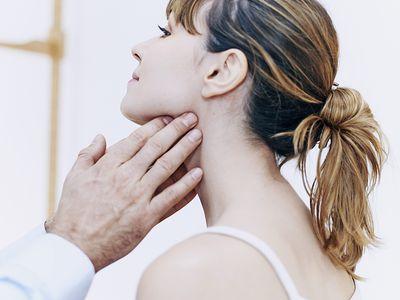 Doctor palpating a patients Lymph Nodes