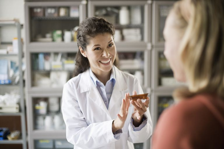 A pharmacist informing patient about a new prescription