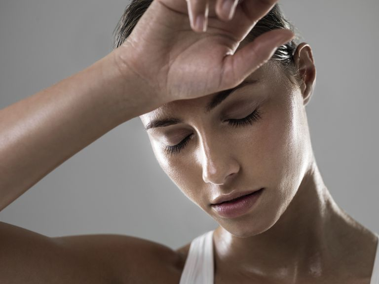 Woman wiping her forehead