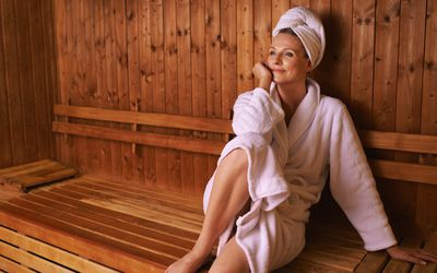 Woman relaxing in dry sauna
