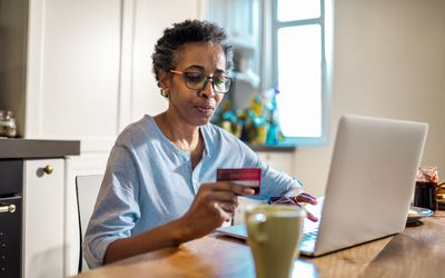Older woman making an online payment.