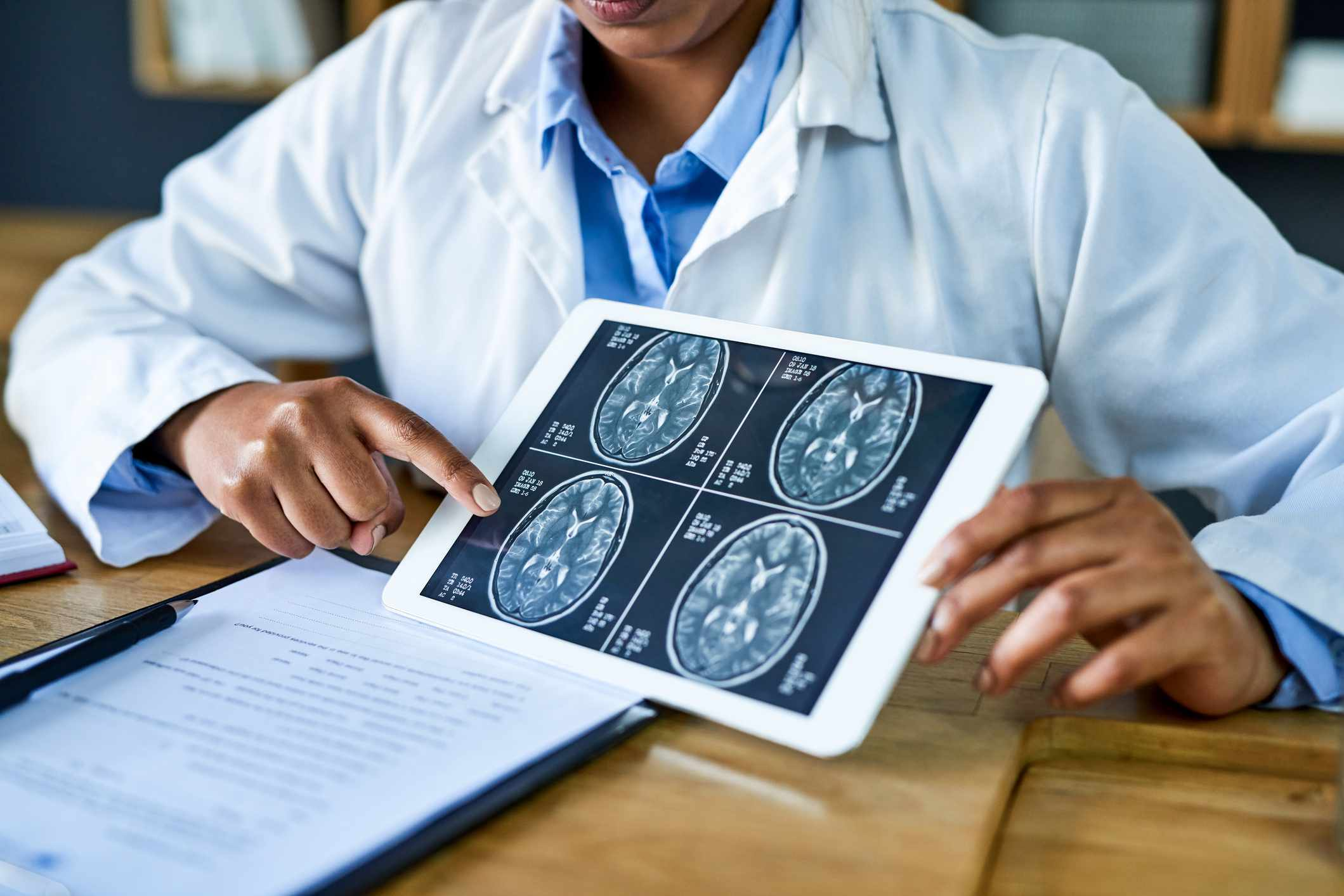 a neurologist showing MRIs