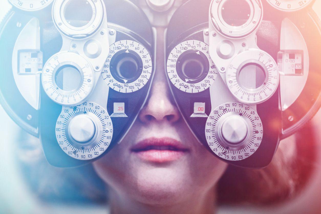 Woman taking an eye exam