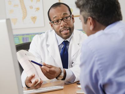 Doctor speaks to a male patient about his fertility
