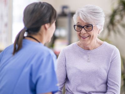 senior woman talking to doctor and smiling