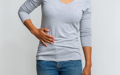 a woman with liver pain