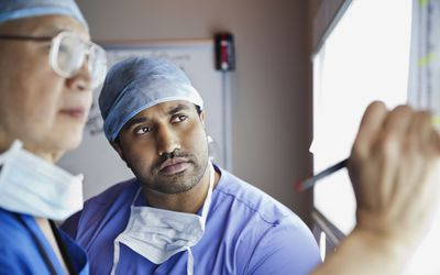 Surgeons analyzing report together in clinic