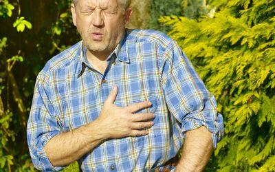 Senior gardener having heart attack.
