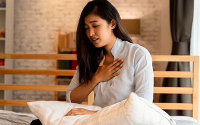 young woman having difficulty breathing
