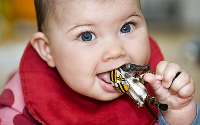 Baby licking and mouthing action figure