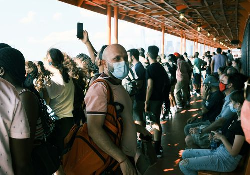 People ride on the Staten Island Ferry in New York City on July 30, 2021.