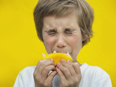 Child sucking on a lemon