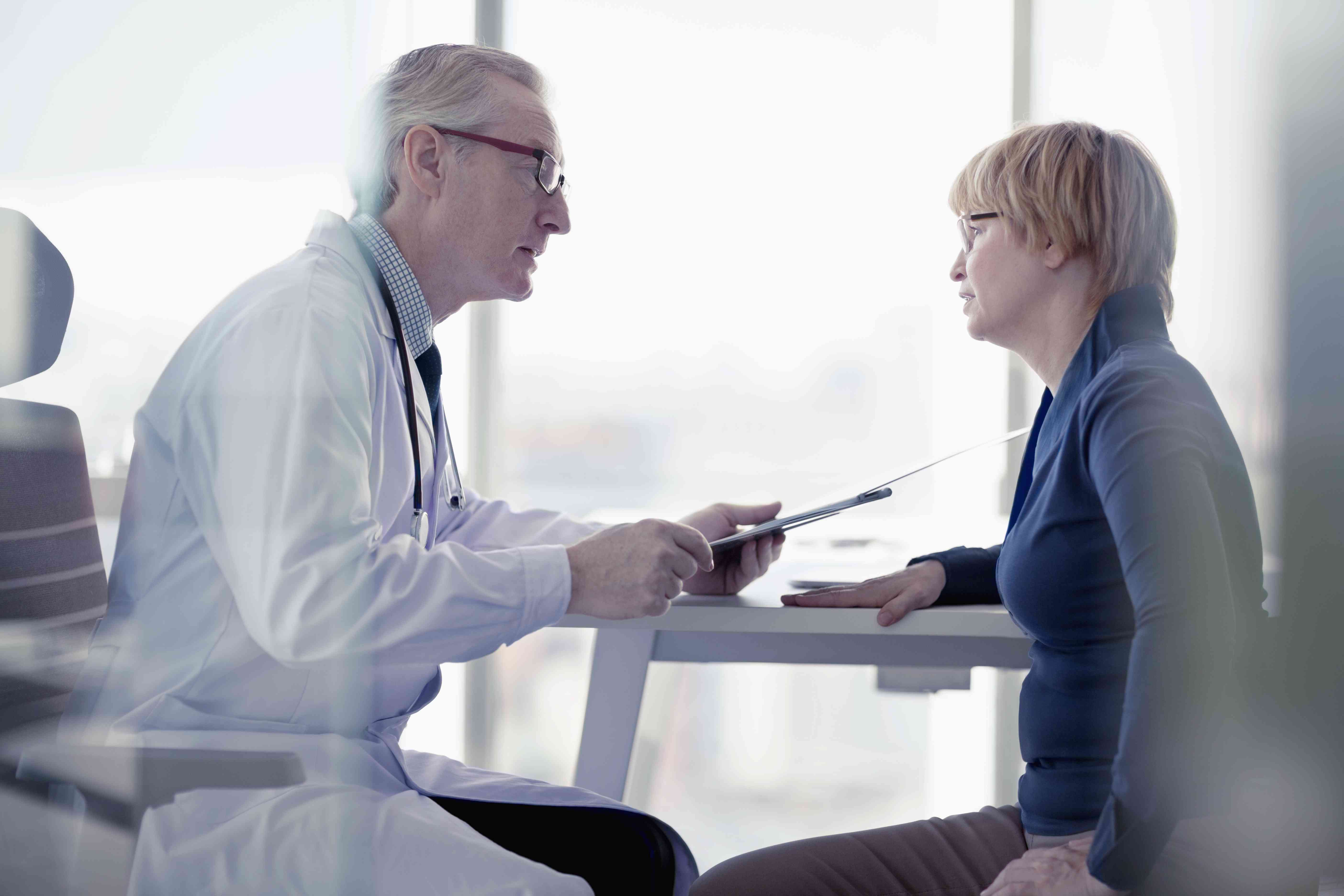A doctor talking to his patient in his office