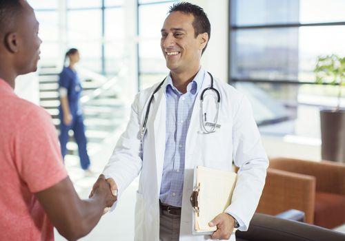 patient doctor shaking hands