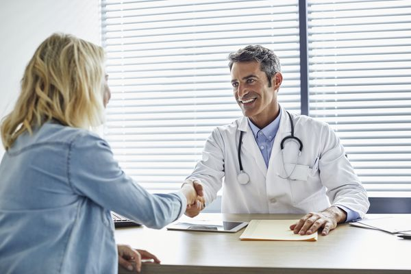 woman meeting with doctor after weight loss surgery recovery