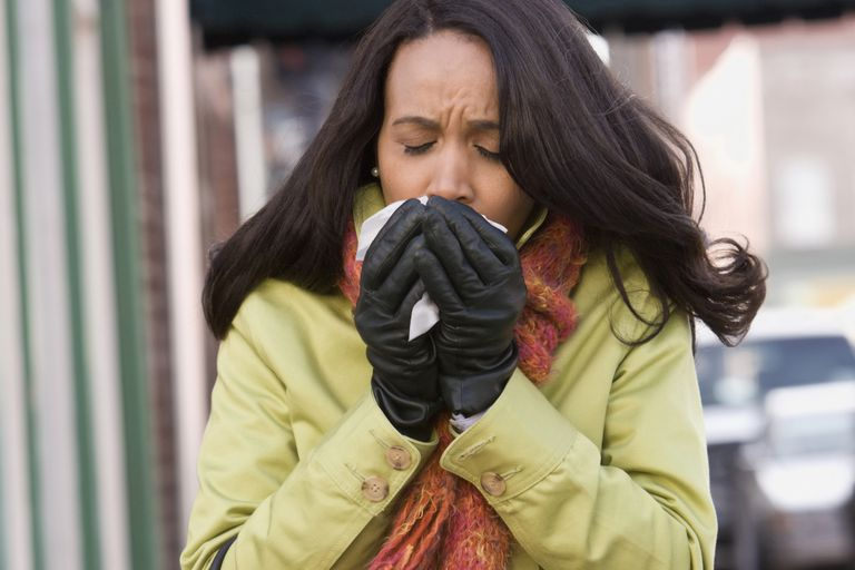 Woman coughing on the street