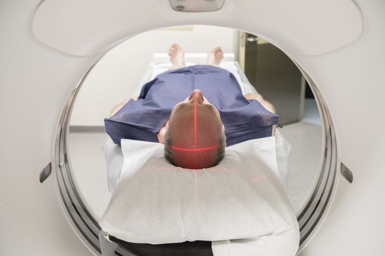 Man receiving MRI to diagnose multiple sclerosis