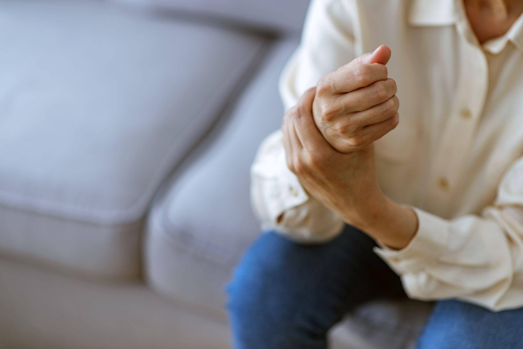 Woman holding her wrist symptomatic