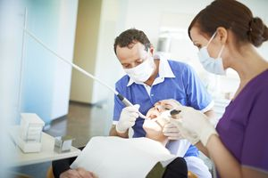 Woman getting her teeth cleaned at the dentist