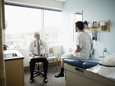 A patient and doctor in discussion in an exam room