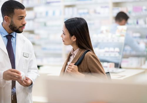 Woman getting advice from a pharmacist
