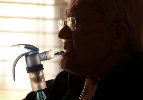 Elderly Man Using Nebulizer