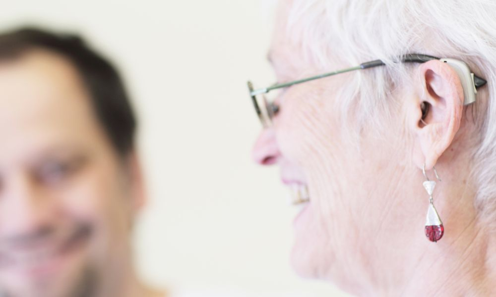 Close up of womans hearing aid