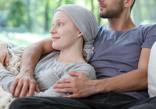 Husband hugging wife with cancer
