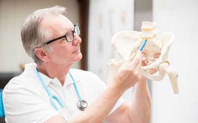 Doctor pointing to the sacrum