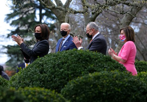 Kamala Harris, Joe Biden, Chuck Schumer, and Nancy Pelosi, wearing masks and making comments regarding the passage of the American Rescue Plan.