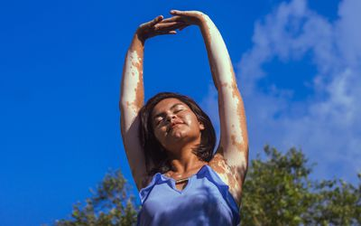 Woman stretching her arms - stock photo