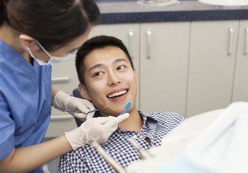 Man getting his teeth cleaned