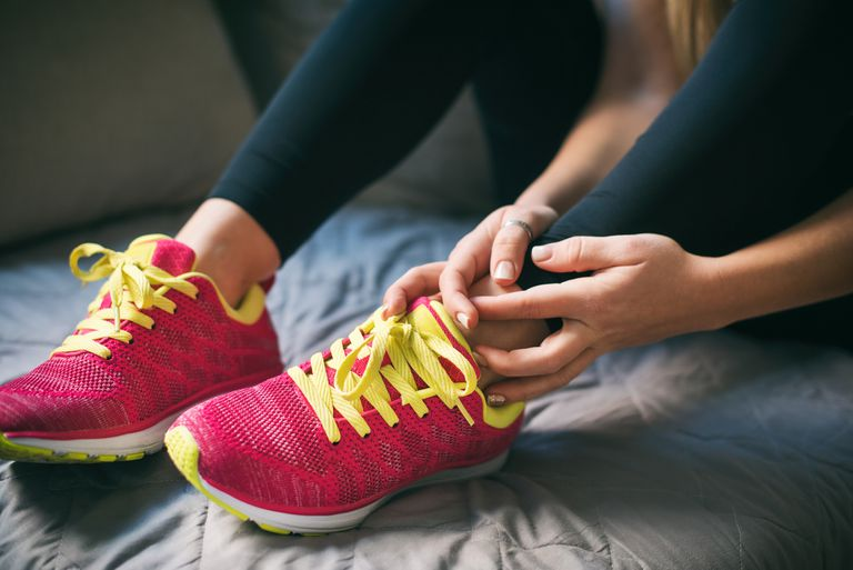 Young sport woman with injured ankle